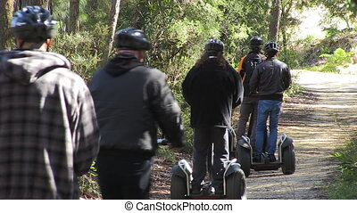 Riding Segway's on a trail - A shot of people riding...