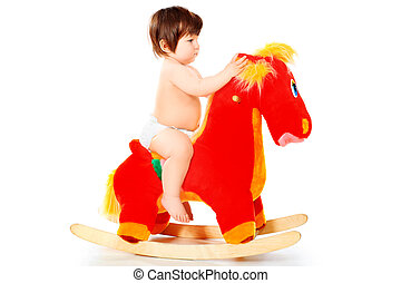 riding - Beautiful little child riding her toy horse....