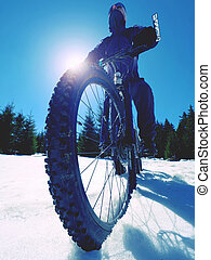 Riding the Mountain Bike in the Snowy Winter Forest. Crazy adventure.