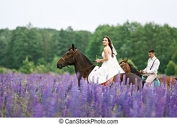 Riding the newlyweds on the field