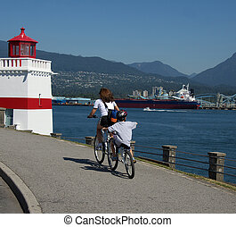 mother and child riding tanem bike on the Stanley park seawall