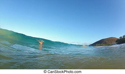 Riding the Wave - Surfer Catches Wave on Boogie Board at the...