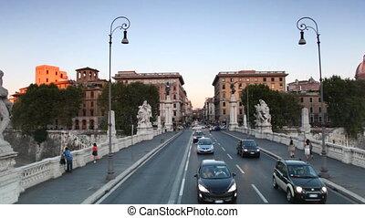 Riding through bridge Ponte Vittorio Emanuele II across Tiber