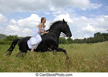 riding wedding woman - galloping beautiful wedding woman on...