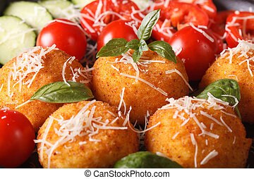 ried arancini rice balls with vegetables macro. horizontal...