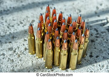 ammunition - rifle ammunition on concrete