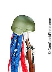 Rifle and helmet memorial - Military helmet on old WWII...
