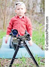 Rifle barrel and child