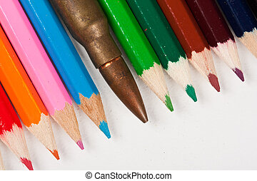 Rifle bullet lying in a row with pencils