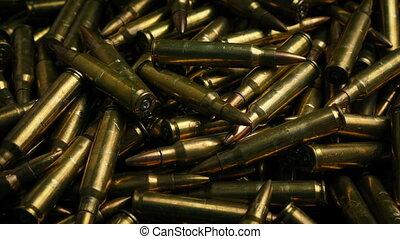 Rifle Bullets Moving Shot - Tracking shot moving slowly past...