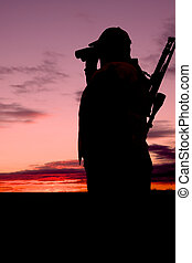 Rifle Hunter in Sunset