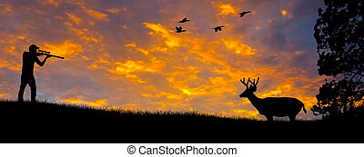 Silhouette of a hunter aiming at a White tail buck against an evening sunset.