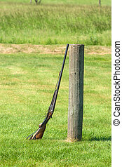 Rifle on a green meadow