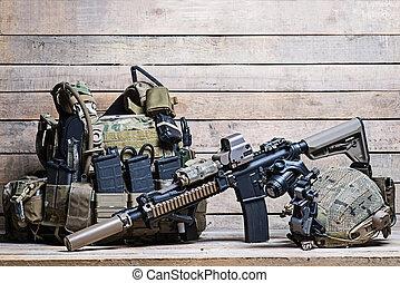 Rifle,flak jacket and helmet