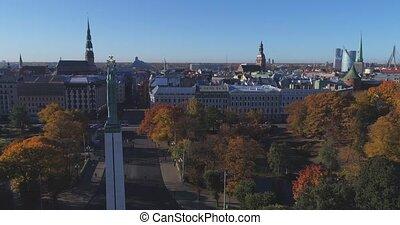 Riga city day time bridge Autumn Drone flight Milda monument