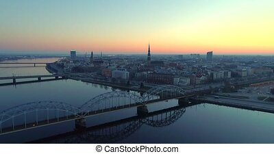 Riga city Evening and Night time Old town Riga Drone flight over Roads and River Train Bridge