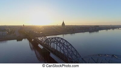Riga city morning sunrise time Old town Riga Drone flight over Roads and Train Bridge