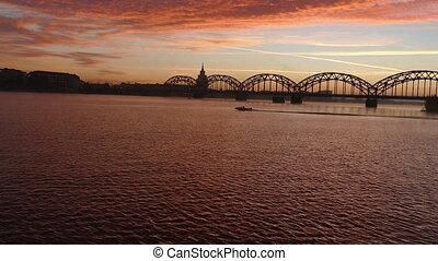 Riga Iron Railway bridge over River Daugava at sunrise