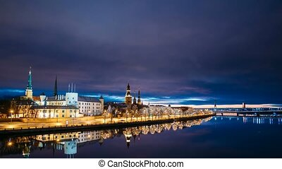 Riga, Latvia. Time Lapse Timelapse Time-lapse Of Cityscape In Morning Sunrise Time. Night View Of Castle, Dome Cathedral And St. Peter's Church. Popular Place With Famous Landmarks. UNESCO