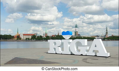 """Riga sign, majestic clouds, city view, timelapse, 4k"""