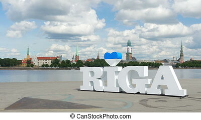 """Riga sign, majestic clouds, city view, timelapse, zoom in, 4k"""