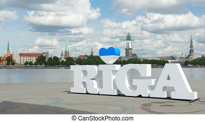 """Riga sign, majestic clouds, city view, timelapse, zoom out, 4k"""