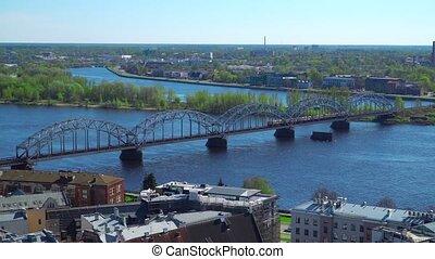 Riga skyline, Latvia. Aerial view of Riga. Train passing...