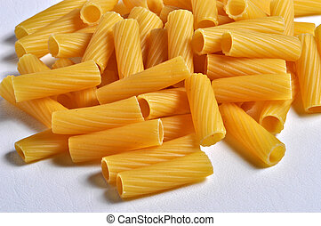 Rigatoni Pasta - A pile of rigatoni pasta sits on a plain ...