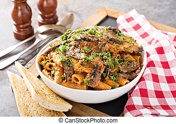 Rigatoni pasta with creamy sauce and mushrooms - Rigatoni ...
