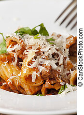 rigatoni pasta with sauce bolognaise and cheese