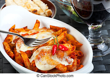 rigatoni pasta with tomato sauce and melted cheese