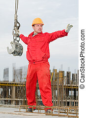 riggwer builder with straps - rigger builder in uniform and...