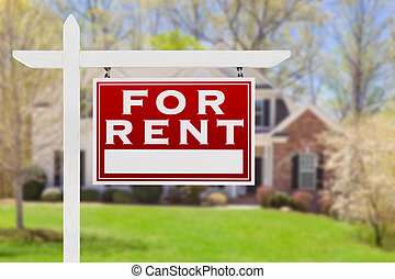 Right Facing For Rent Real Estate Sign In Front of House.