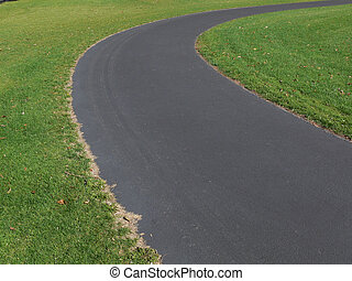 Right hand curve in suburban park walking path.