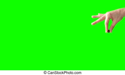 Right hand drops brown pill over green background, loopable