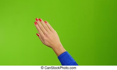Right hand is widely waving goodbye or hello. Green screen