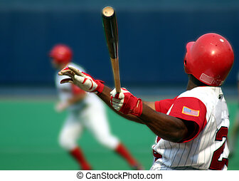 Right-handed baseball batter, close-up right-handed, swinging hard
