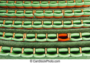 Right place - Conceptual image of disoccupated green seats...