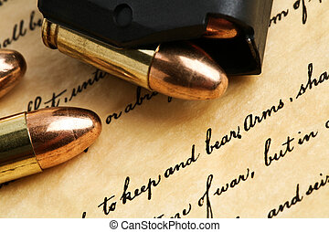 right to keep and bear arms - US Constitution Bill of Rights with 9mm bullets and magazine