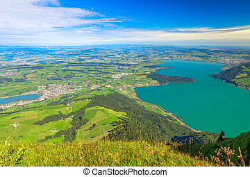 Panoramic views along hiking trail around Rigi Kulm, the highest peak on Mount Rigi over 13 lakes and peaks of the Swiss Alps. Canton of Lucerne, Central Switzerland.