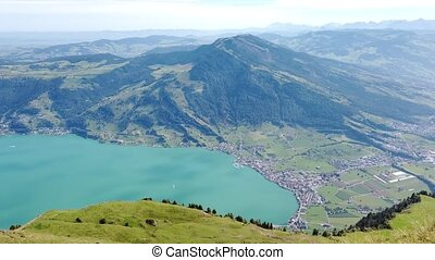 Panoramic summer landscape over Lake Lucerne, Lake Zug and Swiss Alps from Rigi-Kulm viewpoint summit of Mount Rigi. Alpine scenery toward mountain peaks in Canton of Lucerne, Central Switzerland.
