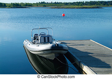 Rigid inflatable boat at a pier - Rigid inflatable boat...