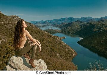 Rijeka Crnojevica, Montenegro. Girl sexy brunette tourist sightseeing amazing view of Skadar lake national park, Pavlova Strana. Viewpoint Ridge mountains panoramaic landscape.