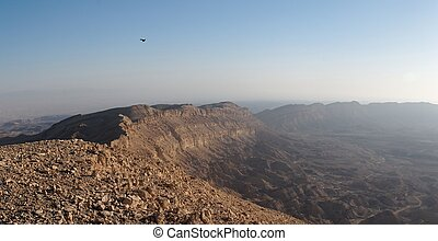 Rim of desert canyon at sunset in the Small Crater (Makhtesh Katan) in Israel's Negev desert