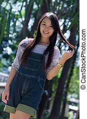 Rimight Portrait Beautiful asian woman in Park