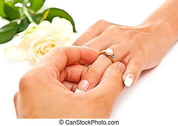 Ring and hands - Man\'s and woman\'s hands with golden ring....