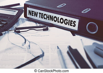 Ring Binder with inscription New Technologies on Background of Working Table with Office Supplies, Glasses, Reports. Toned Illustration. Business Concept on Blurred Background.