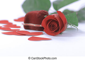 ring in red box with a red rose on the white background