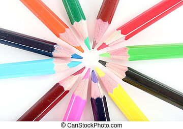 Ring of color pencils on white background