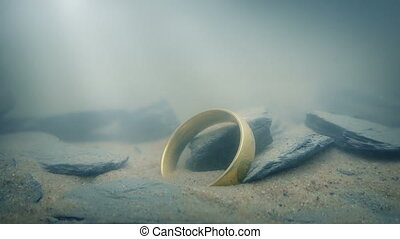 Ring On Lake Floor In Sun Rays - Gold ring deep underwater...
